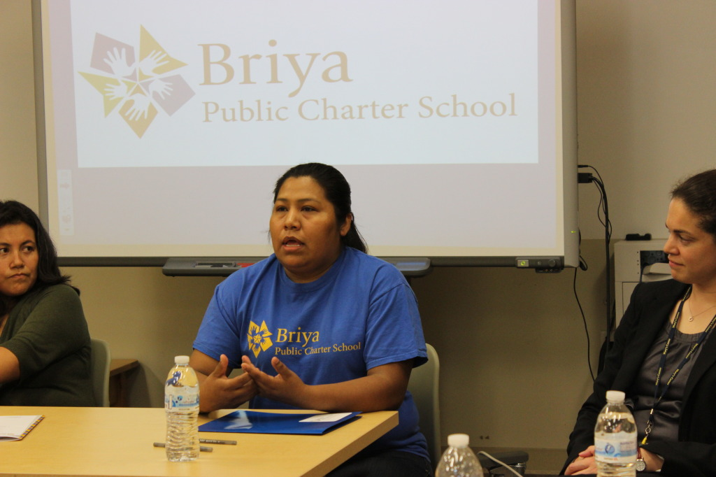 Briya student speaks to the group about Briya's family literacy programs