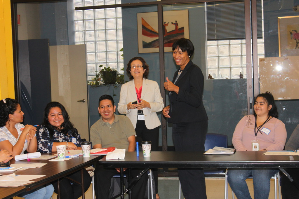 Mayor Bowser gives thumbs up to the student council members
