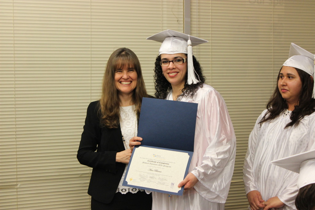 Christie McKay, Executive Director of Briya, with graduates